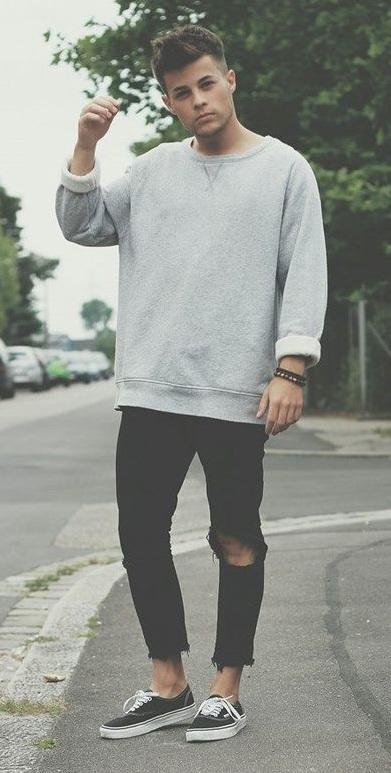 man in torn pants and sweatshirt