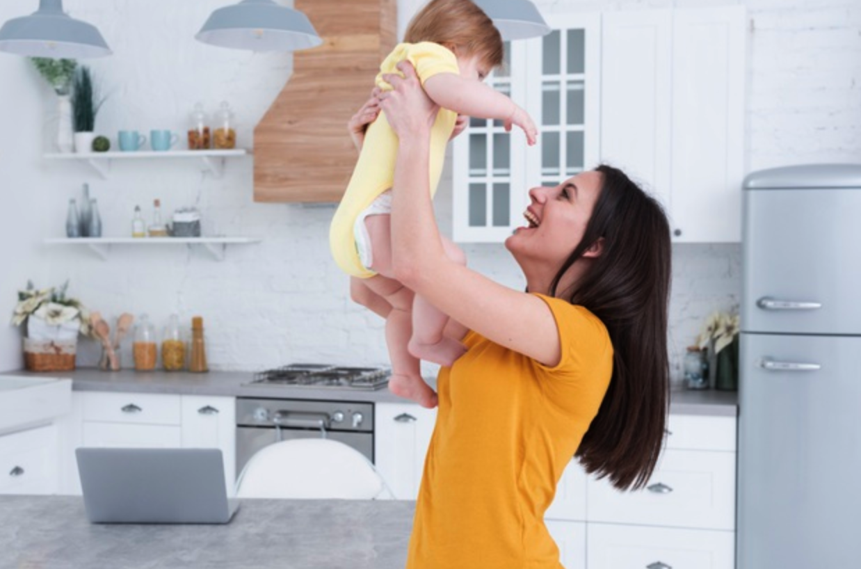 Mother Lifting Child into the Air