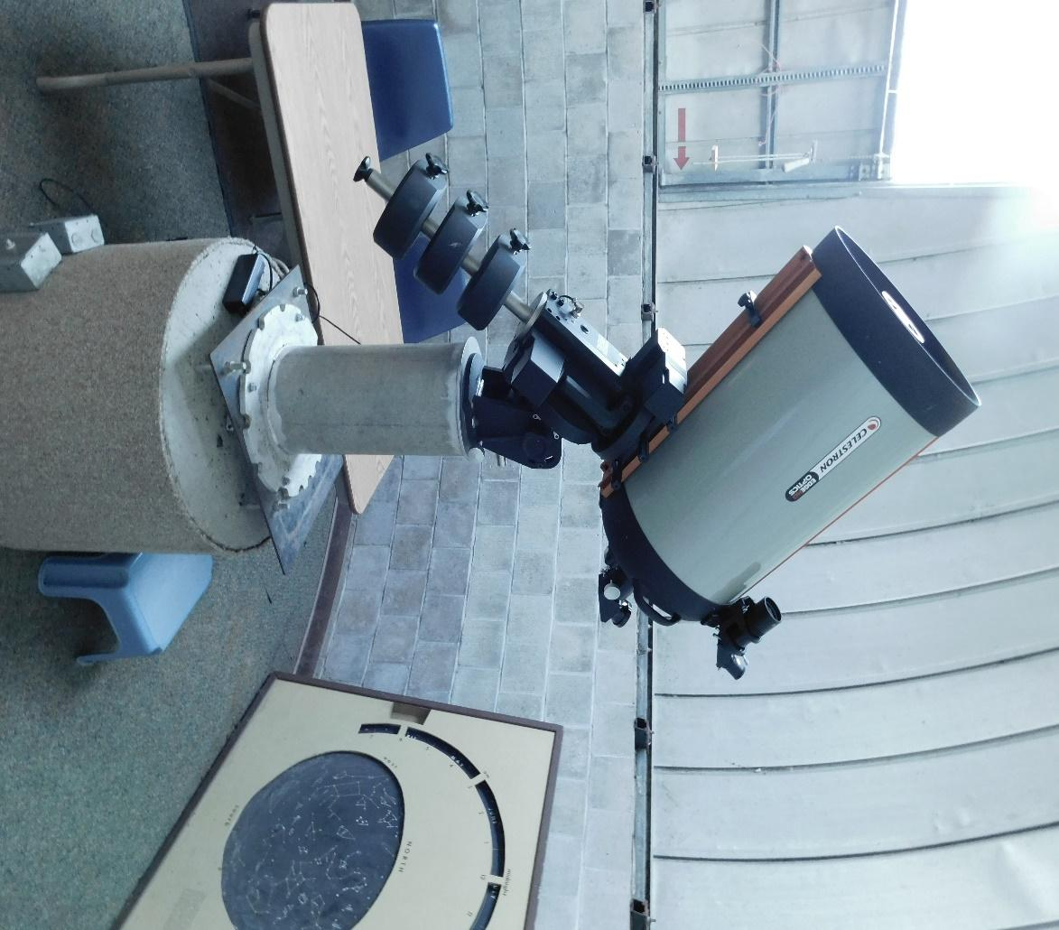 A picture containing object, telescope  Description generated with very high confidence