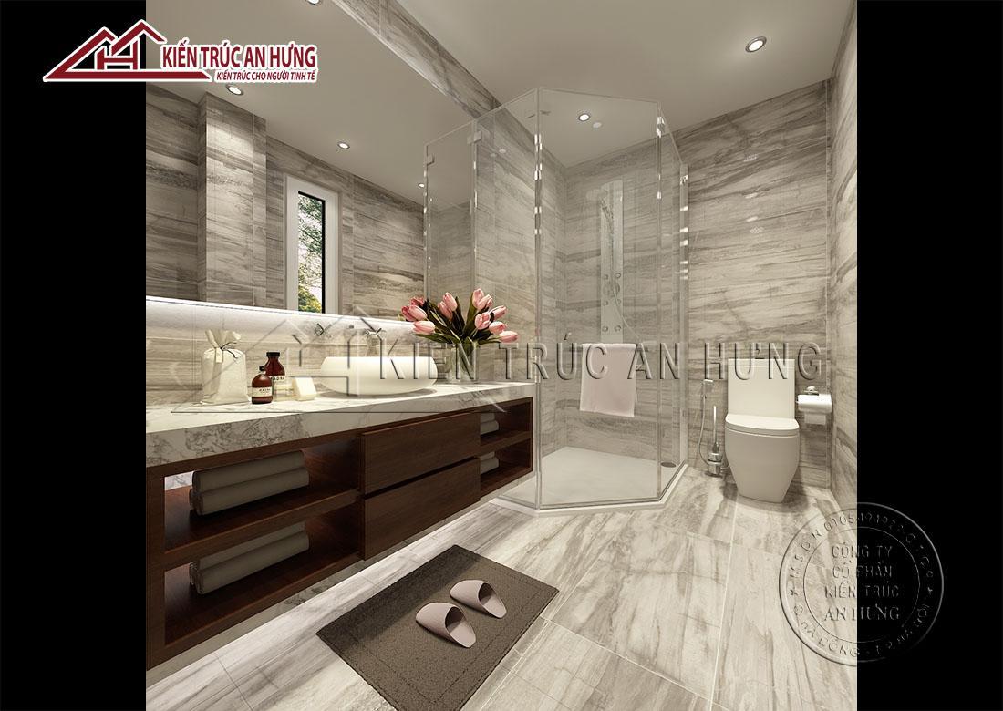 Phòng tắm trông sang trọng, lịch sự, sạch sẽ với tông màu xám đá làm chủ đạo kết hợp với vật liệu bằng kính, đá