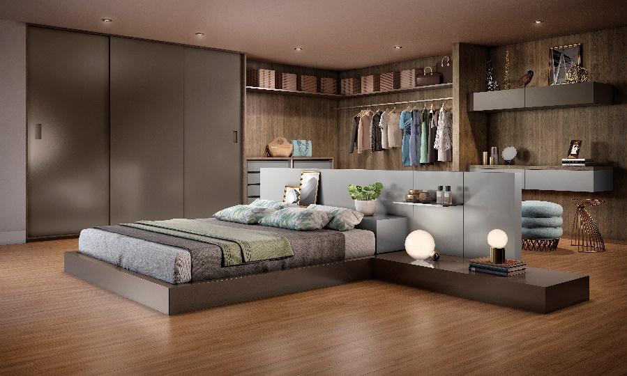 Quarto com piso de madeira, cama baia com cabeceira de MDF cinza, guarda roupa de madeira escura com closet e escrivaninha.