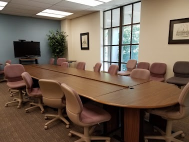 Seats 11-15 people; windowed room containing a large table and chairs