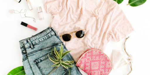 An outfit with a pink t-shirt, sunglasses, a pink cosmetician,a  jean and accessories.