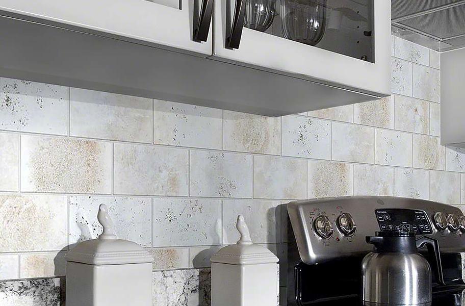 textured white subway tile as kitchen backsplash