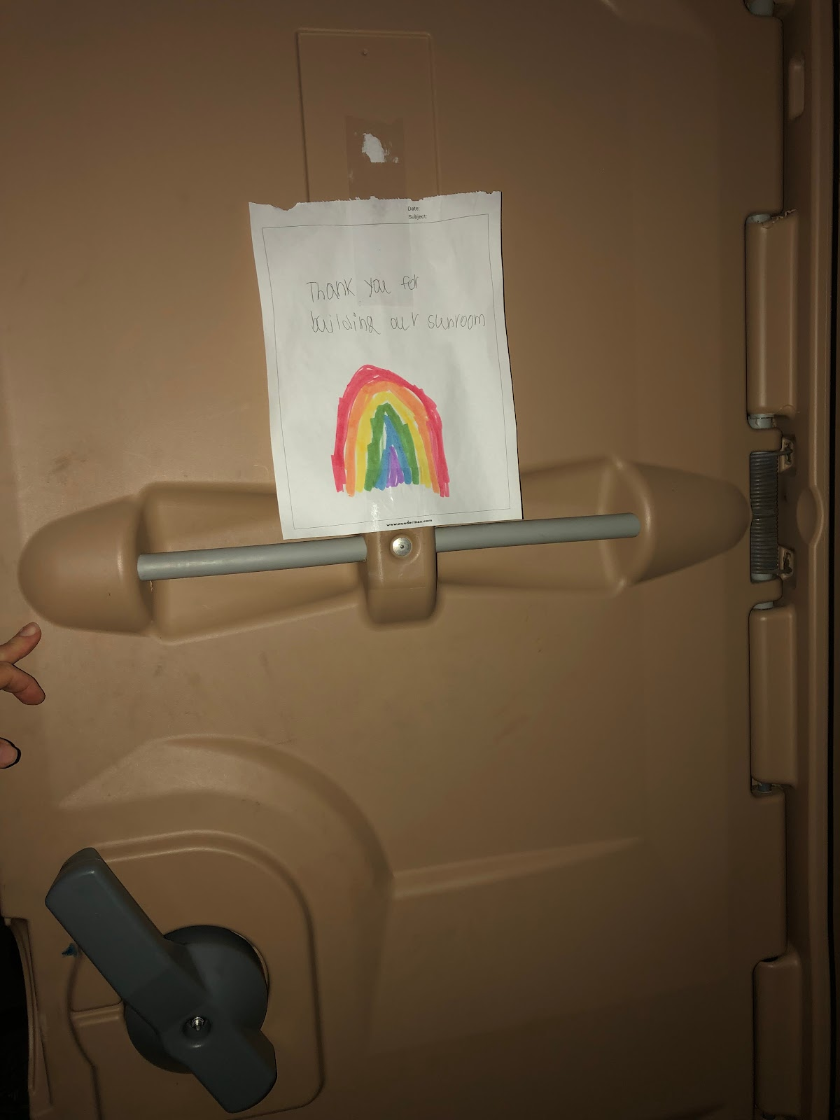 cute note drawing rainbow from little girl placed in porta potty to thank workers for building home