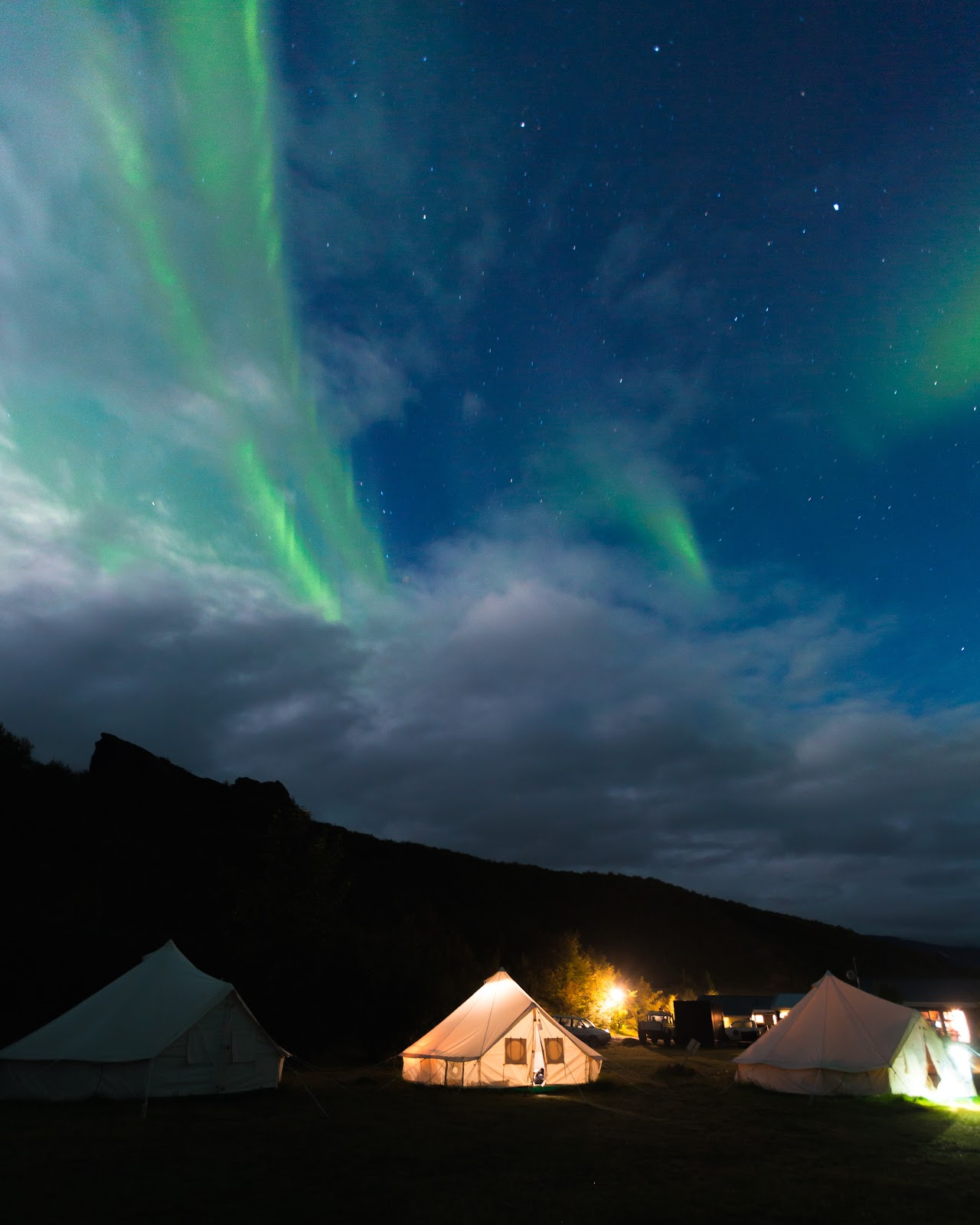 Glamping tents under Northern Lights
