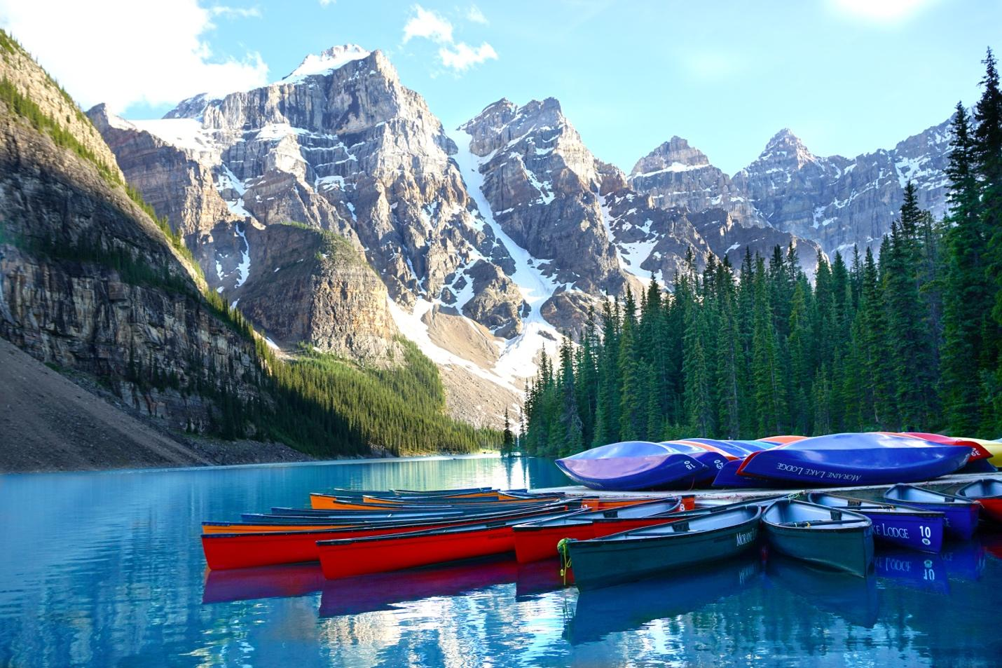 A picture containing sky, mountain, outdoor, water  Description automatically generated