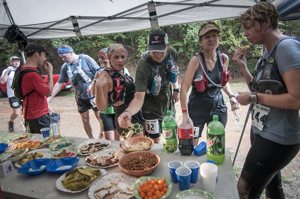 An aid station with salty snacks and sugary drinks at the Yeti Snakebite 50K ultra-marathon.