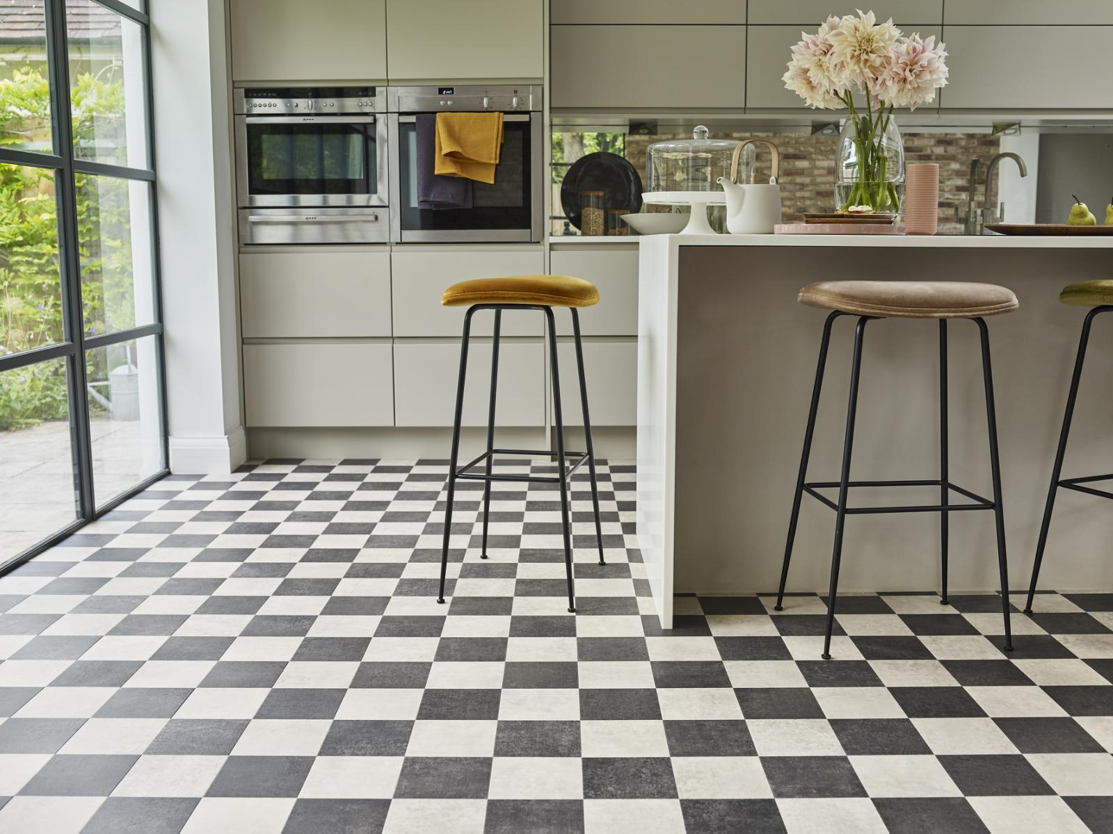 A kitchen with black and white tiles  Description automatically generated with medium confidence