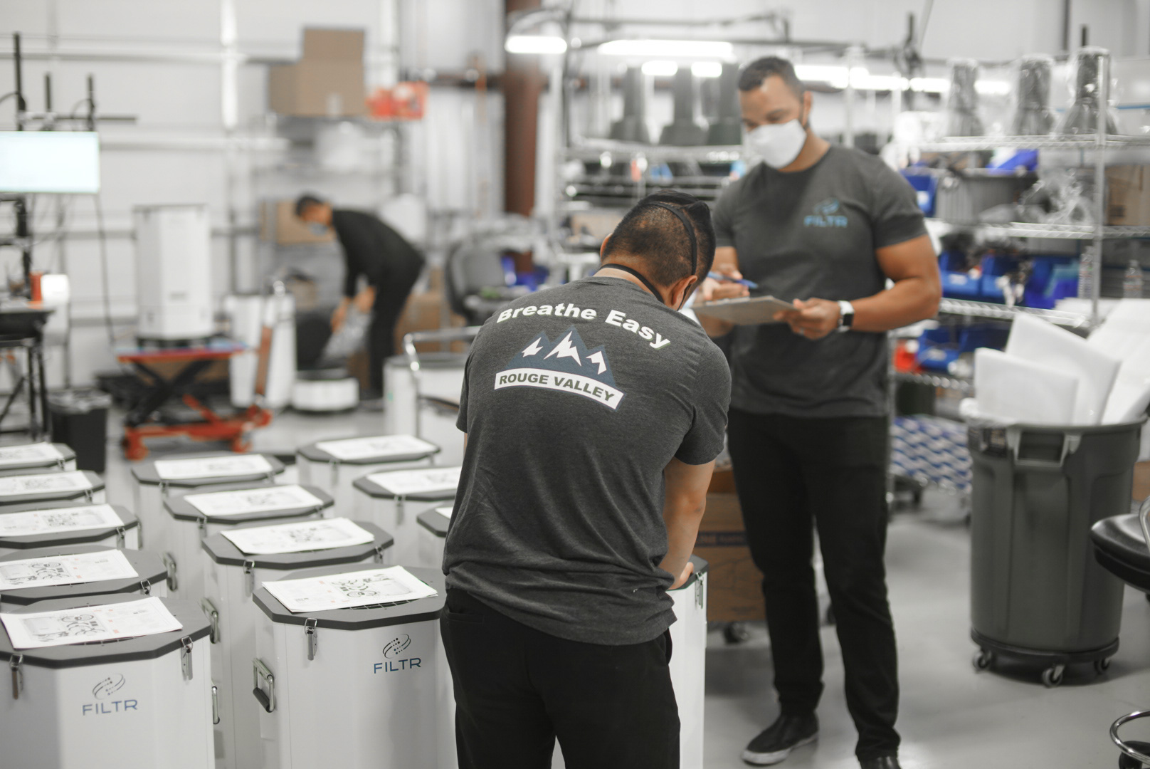 Aighthouse Worldwide Solution and Filtr employees prepare the cleanroom grade air purifiers to be installed in local businesses to help with Southern Oregon air quality.
