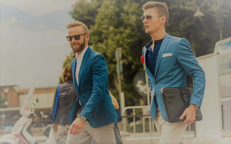 2 guys wearing elagant coats
