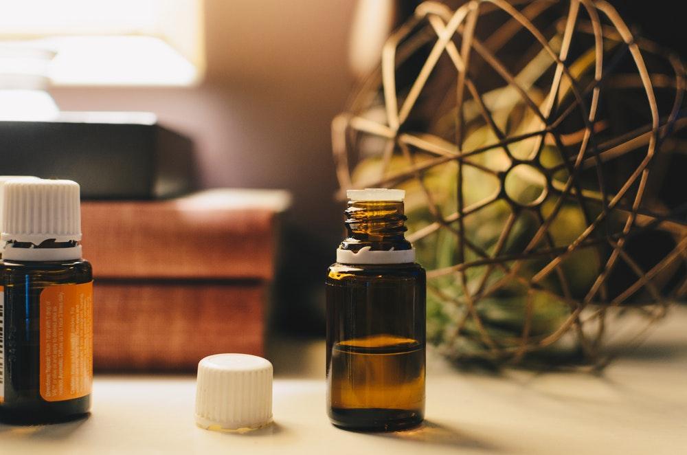 opened amber glass vial bottle