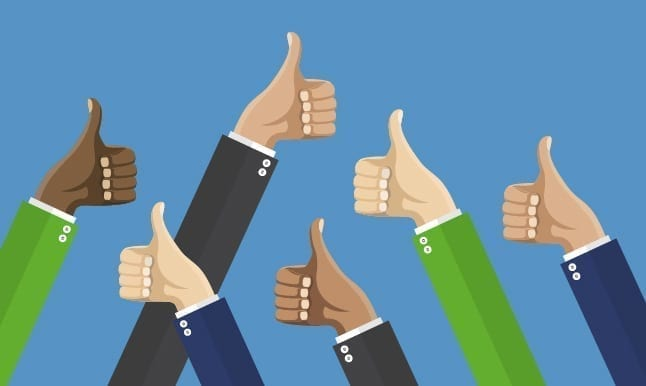 image of people giving the thumbs up