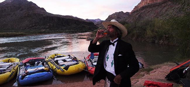 P.T. Wood enjoys a glass of craft spirits near the shores of the Colorado River.