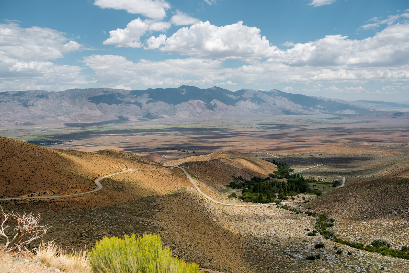 Cycling Owens Valley - Onion Valley Road, hairpins, valley mountains, clouds and sky