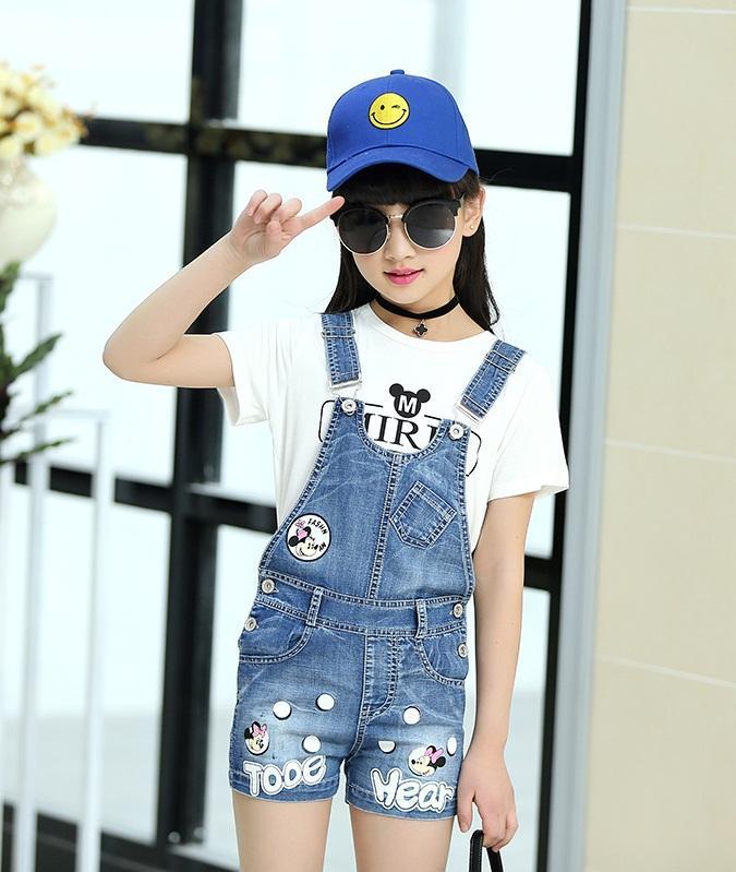 spodnie ogrodniczki jeansowe z dziurami dla dziewczynki13