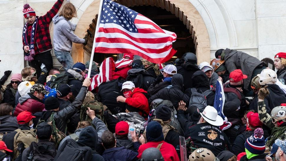 Rioters clash with police trying to enter Capitol building