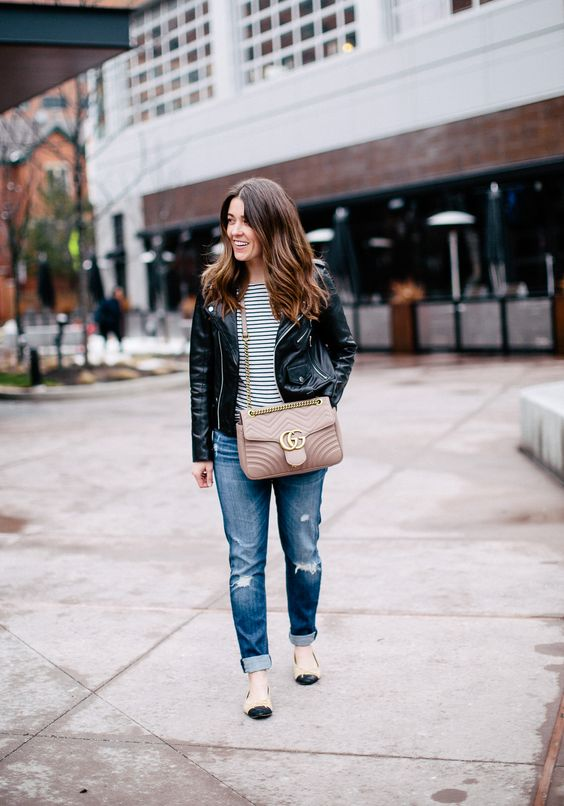 woman wearing a petite leather jacket with stripped tee