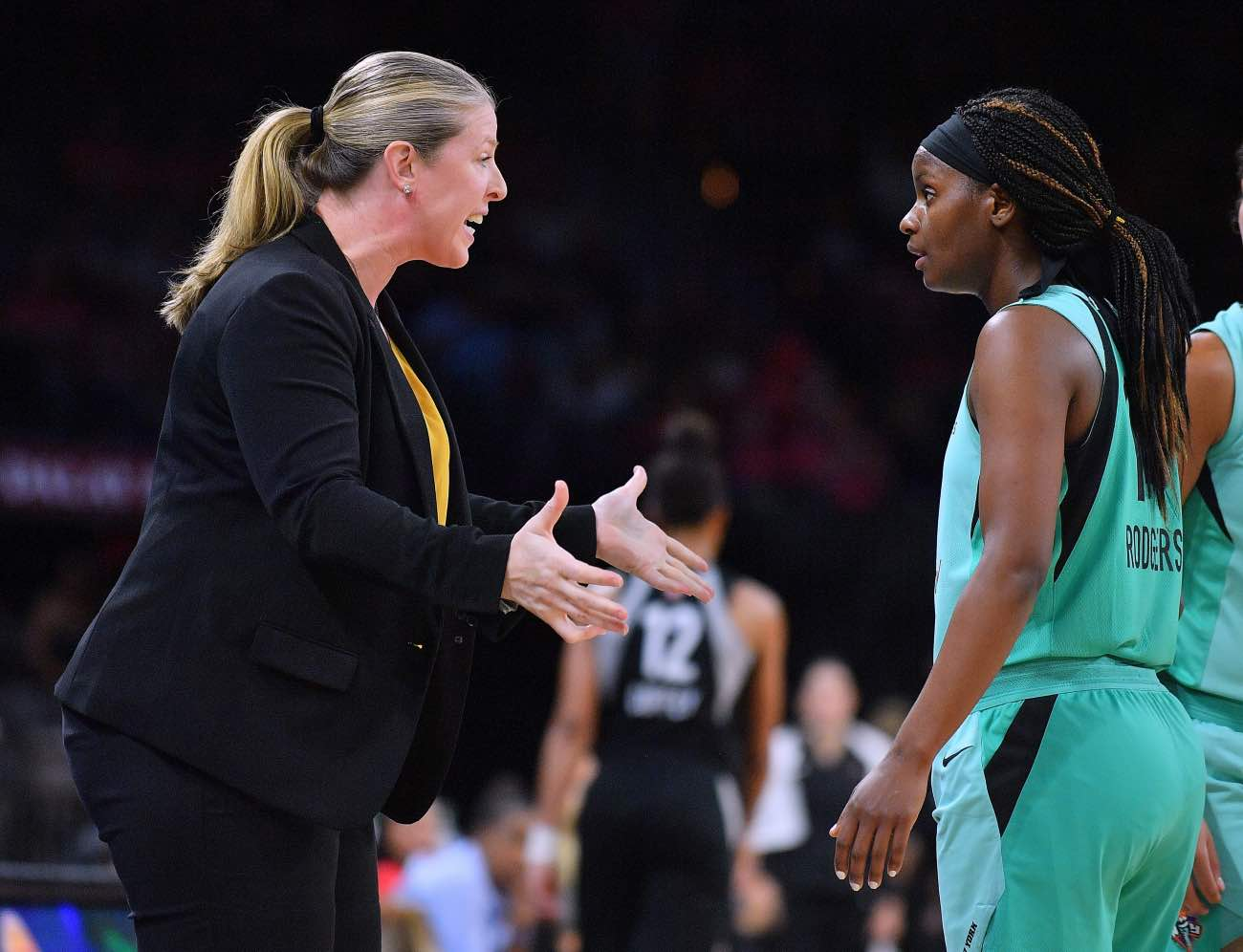 LAS VEGAS, NV - AUGUST 15: Head coach Katie Smith of the New York Liberty talks to Sugar Rodgers #14 of the New York Liberty during a timeout of their game against the Las Vegas Aces at the Mandalay Bay Events Center on August 15, 2018 in Las Vegas, Nevada. (Photo by Sam Wasson/Getty Images)