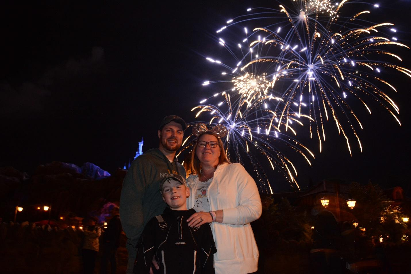 Disney's Memory Maker photo magic of capturing a family and the castle fireworks!