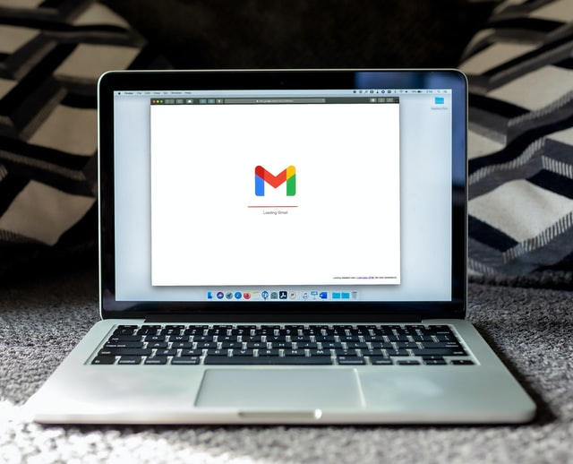 An image of a MacBook Pro with a Gmail webpage loading on it.