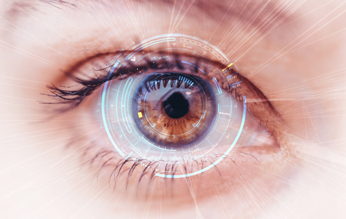 A closeup of an eye with a digital scan of the retina taking place.