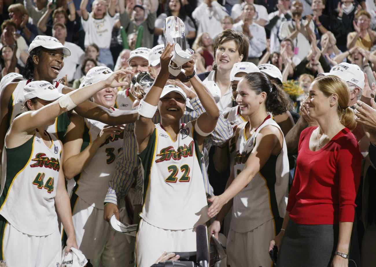 SEATTLE OCTOBER 12: Betty Lennox #22 of the Seattle Storm celebrates winning MVP in game 3 of the WNBA Finals. Lennox scored 23 in the Storm's 74-60 victory over the Connecticut Sun on October 12, 2004 at Key Arena in Seattle, Washington. (Photo by Otto Greule Jr/Getty Images)