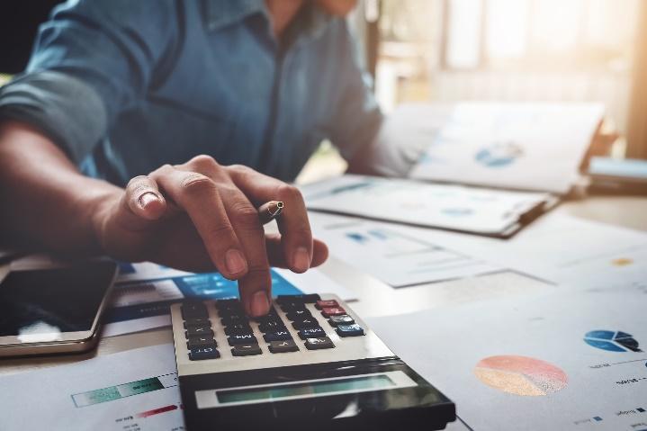 Accountant using calculator