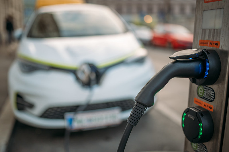 Close up of an electric vehicle charger in Vienna. Electric vehicles still command a very significant price premium over their combustion counterparts, have significant charging limitations, reduced capacity in cold weather, and electricity generation still primarily relies on the burning of fossil fuels such as coal and natural gas in many parts of North America