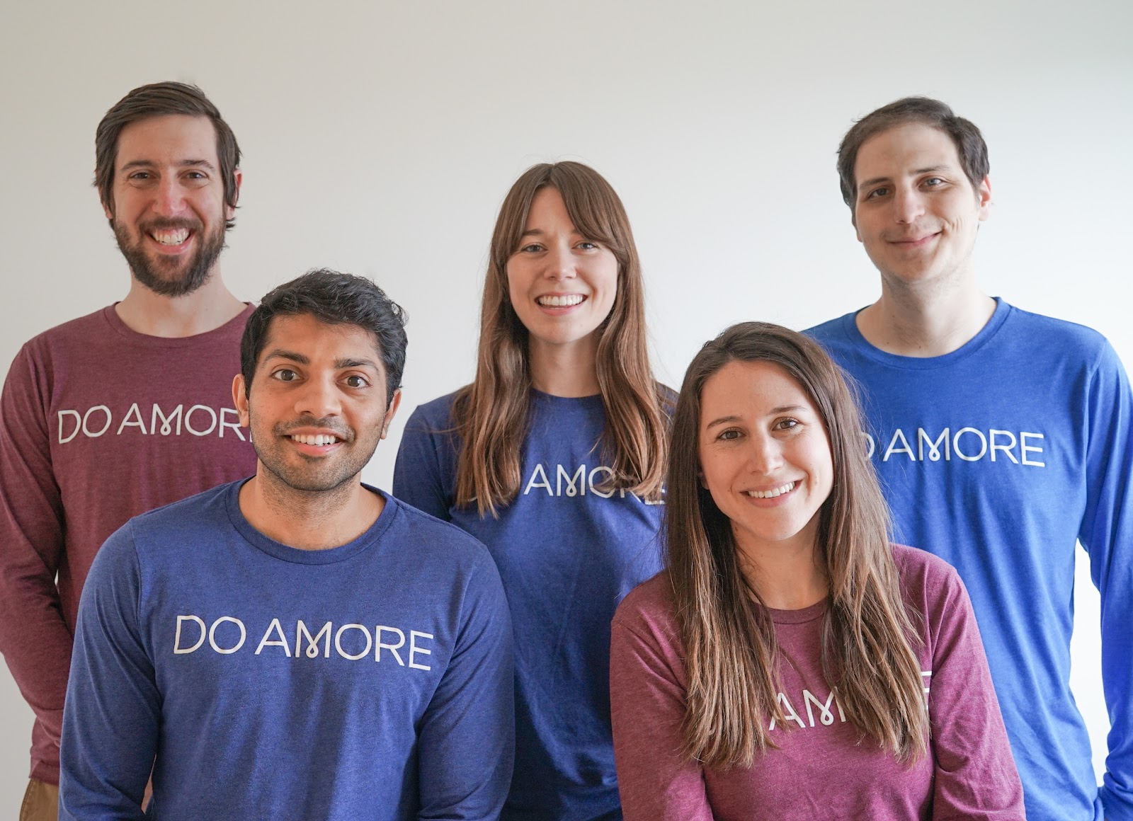 Do Amore's team gathers for a group photo