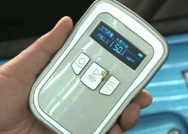 air pollution particle counter monitor used to measure car air pollution levels after cleaning filter