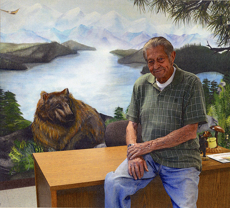 Lowell at his East Sonora office, where a wall mural reflects his passion for bears and the outdoors