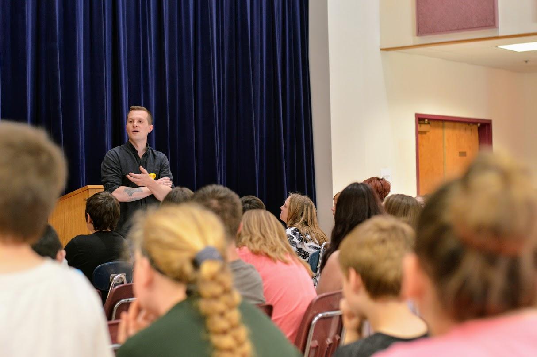 Congressman Golden speaks with students.