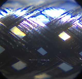 A close-up image of a Galvorn braid composed of untwisted bundles of carbon nanotube fiber