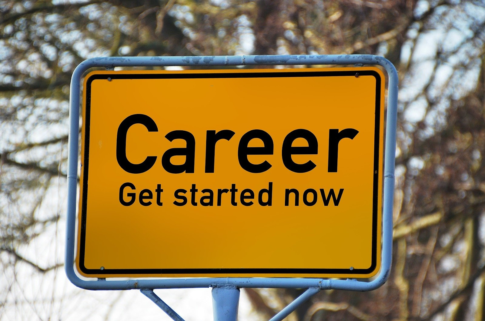 "A yellow sign says ""Career. Get started now."""