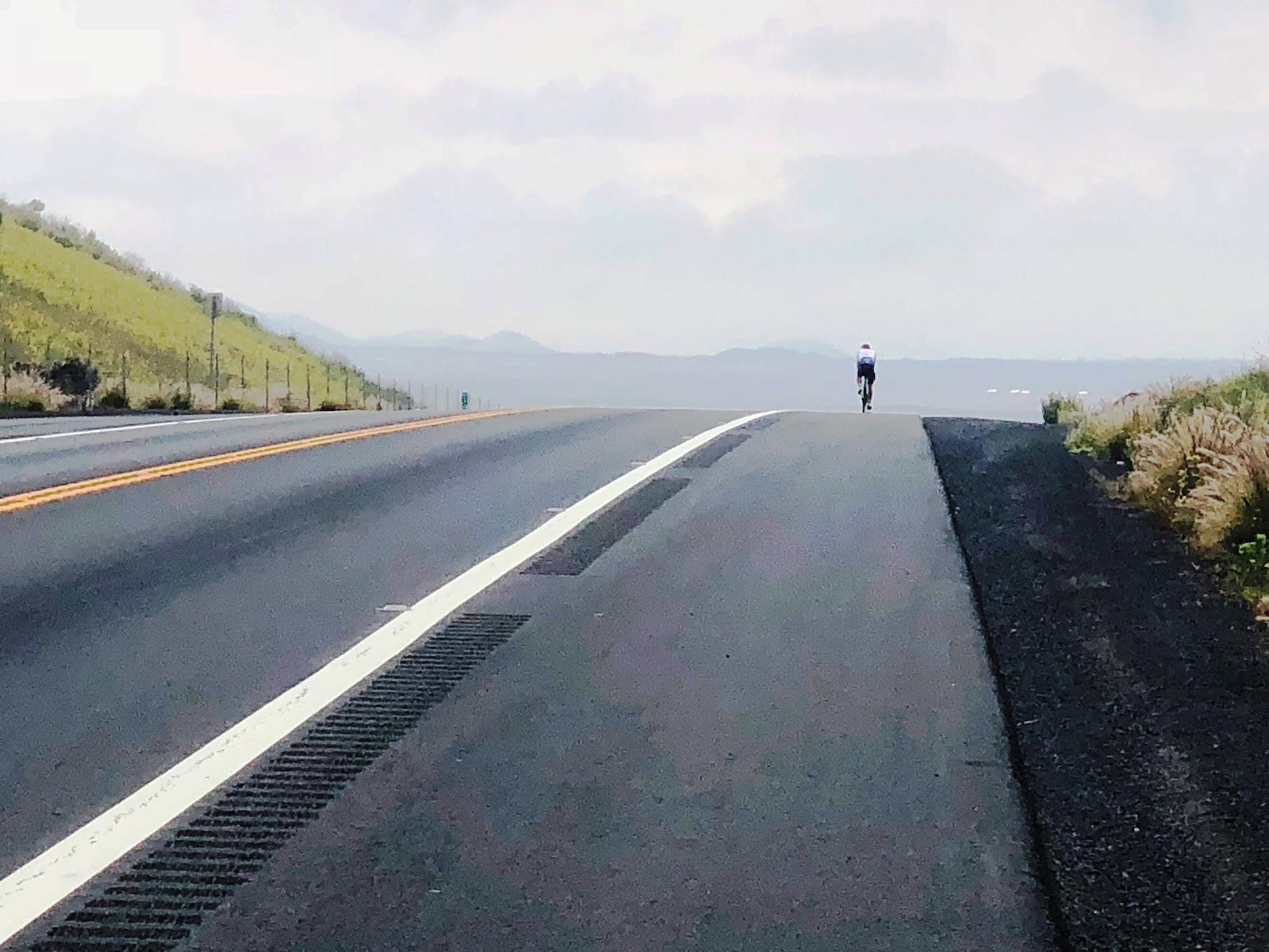 Bike climb Mauna Loa - Cyclist on Hwy 200 - Saddle Road