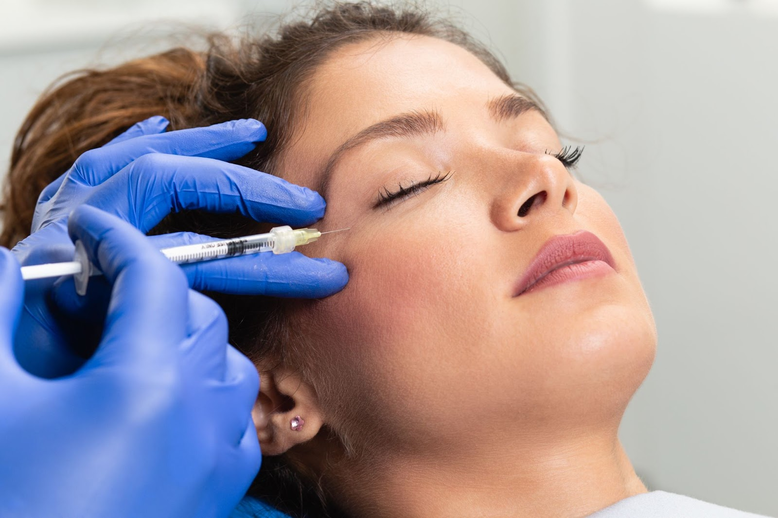 Close up of a trained medical professional doing cosmetic injections