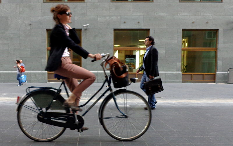 How to be self sufficient - Smartly dressed woman on bicycle