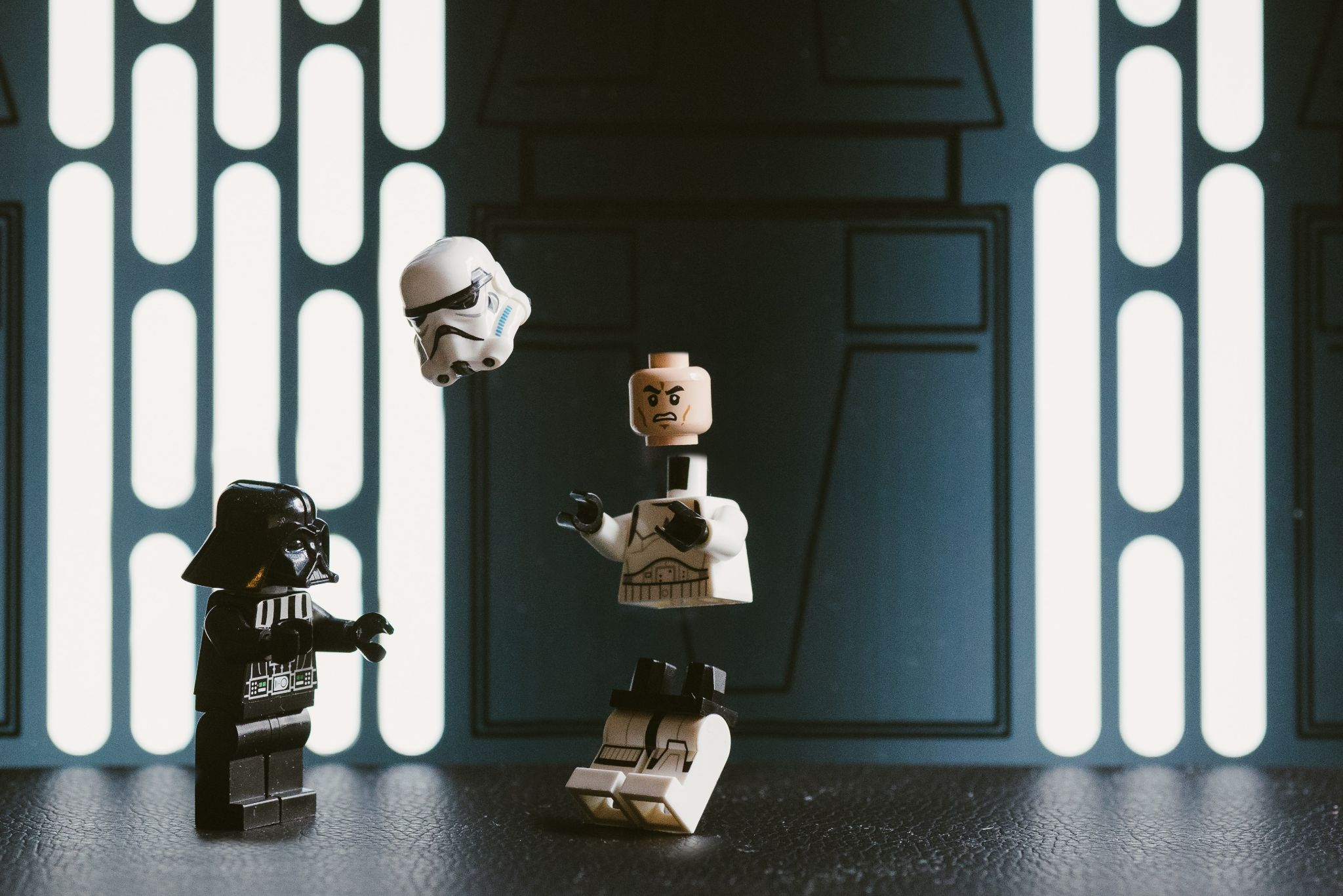 Lego Star Wars Stormtrooper being pulled apart by Darth Vader