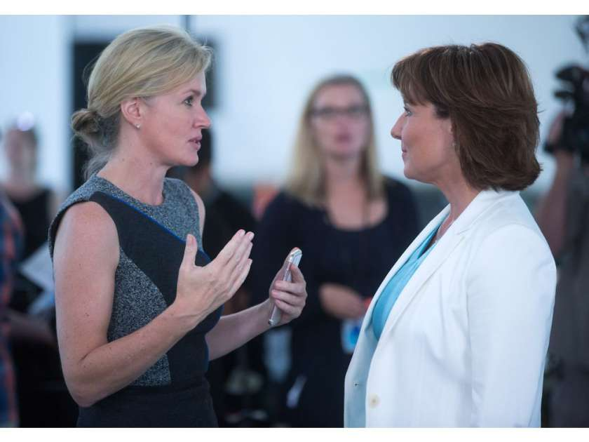 B.C. Hydro CEO Jessica McDonald, left, speaks to British Columbia Premier Christy Clark after she announced the province's climate action plan at the still under construction Carbon Capture and Conversion Institute, in Richmond on Friday August 19, 2016.