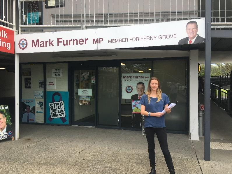 C:\Users\Diana\Documents\AFD Job\2. AFD Event Photos\16. Noosa Shark Nets Trip\Han outside Mark Furners office w petitions.JPG