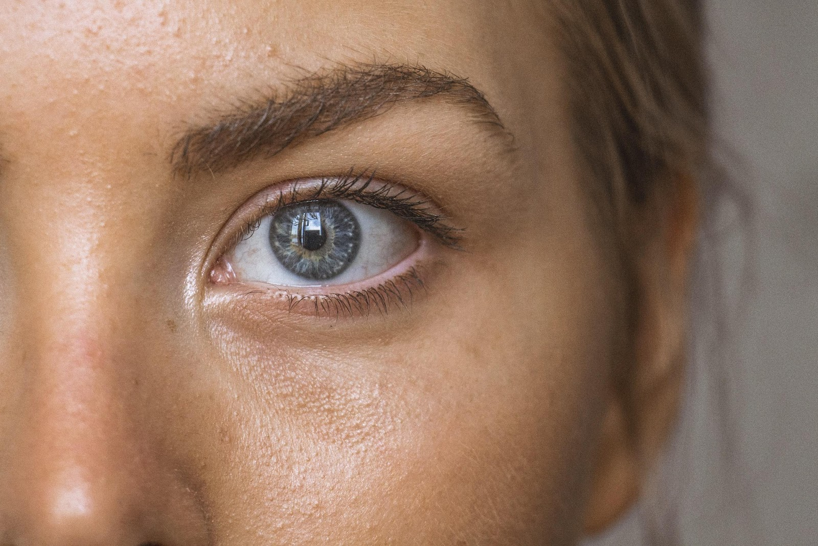 Close up of white woman's blue eye and skin