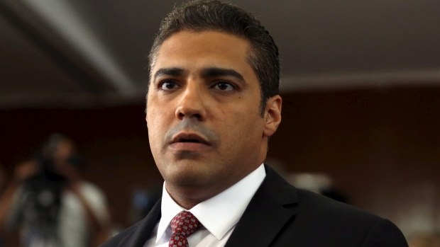 Along with two other Al-Jazeera journalists, Mohamed Fahmy was sentenced to three years in prison after widely denounced trial. Harper's political opponents say he didn't do enough to secure Fahmy's deportation to Canada.