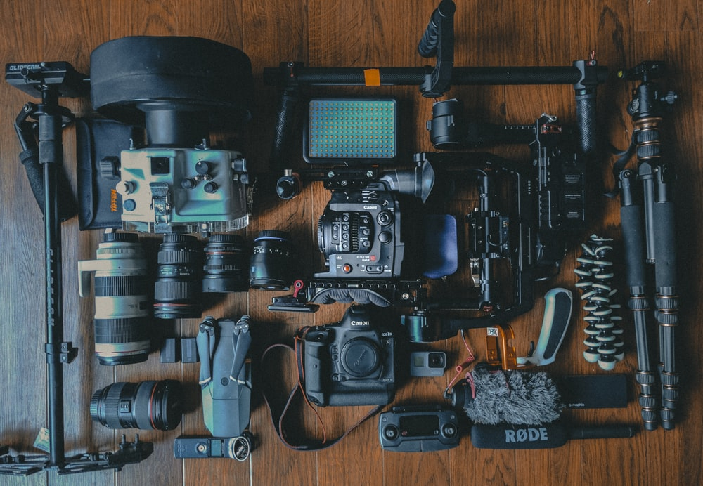 flat lay photography of cameras and camera gear using the right equipment for any job