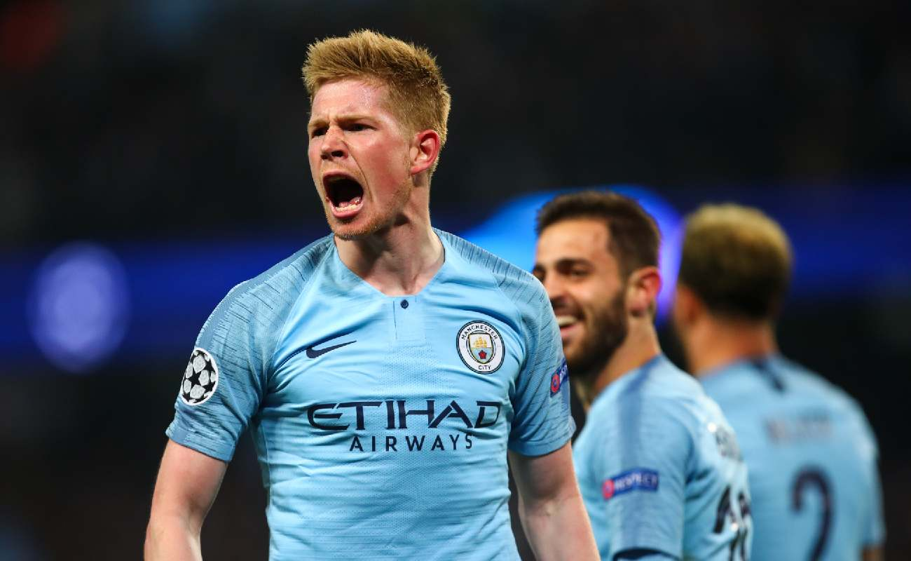 Alt: Kevin De Bruyne of Manchester City shout in celebration of scoring a goal - Photo by Robbie Jay Barratt - AMA/Getty Images
