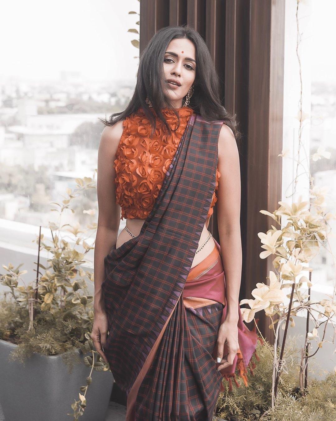 Pradaini Surva latest saree photos Navel Queens