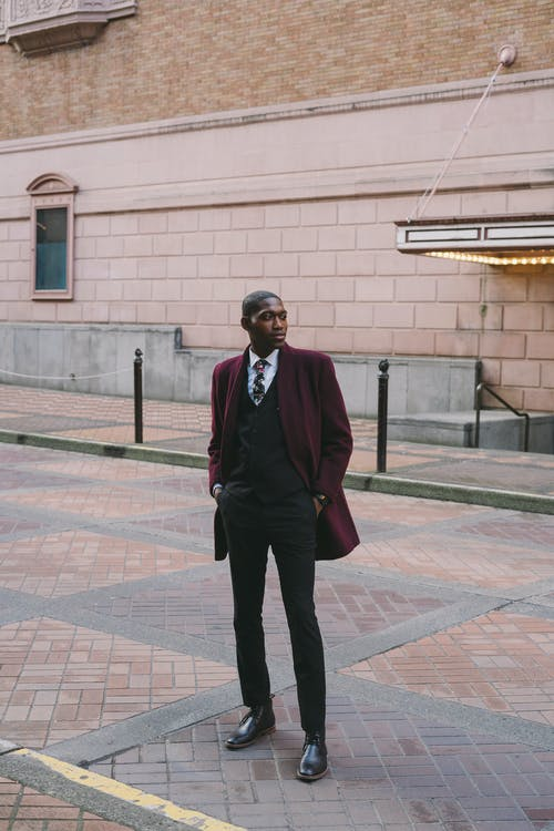 Stylish black man with hands in pockets