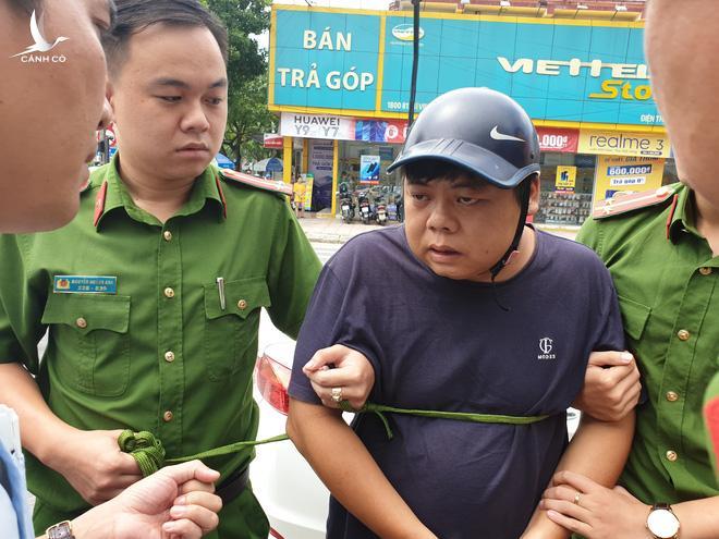 Đối tượng Yang Chang Cai bị công an bắt giữ.
