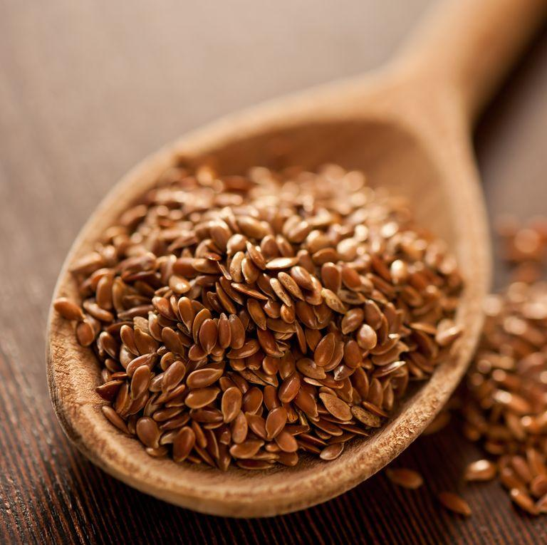close-up-of-brown-flaxseeds-on-spoon-at-table-royalty-free-image-1584457749.jpg