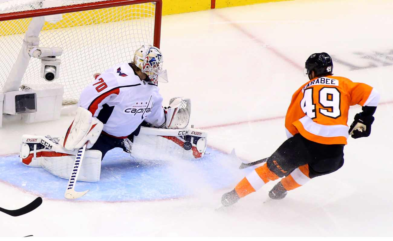 Braden Holtby of the Washington Capitals makes a save against Joel Farabee of the Philadelphia Flyers.